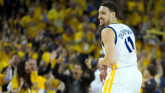 Golden State Warriors guard Klay Thompson (11) smiles after scoring a basket against the Houston Rockets in Game 5.