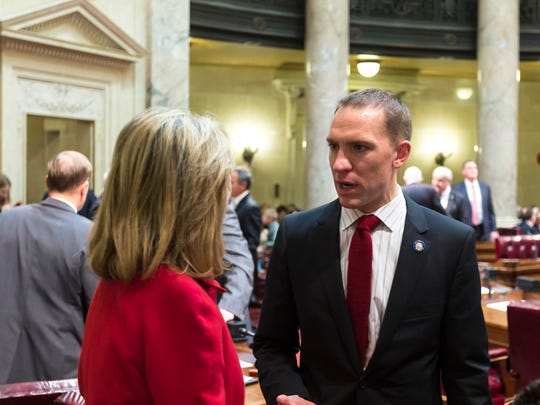 Sens. Chris Larson, right, (D-Milwaukee) and Alberta Darling (R-River Falls) talk before the swearing in ceremony of the 103rd opening session of the Wisconsin State Senate in Madison, Wis.