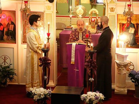 Clergy members of the Holy Trinity Greek Orthodox Church