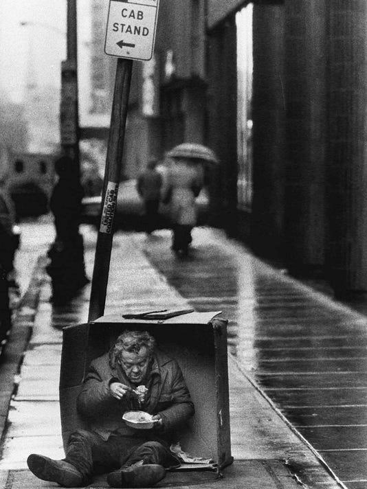 homeless man in box.jpg