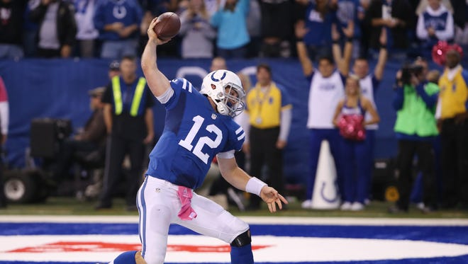 Indianapolis Colts QB Andrew Luck spikes the ball after a big fourth quarter touchdown run against the Ravens on Sunday.