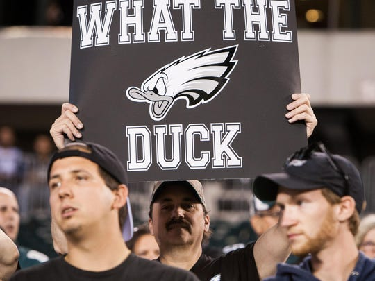 A fan holds up a sign as the Eagles walk off the field losing to Dallas 20-10. The Philadelphia Eagles host the Dallas Cowboys in their home opener at Lincoln Financial Field.