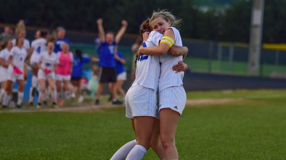 Eastside's Ansley Robinson, right gets a hug from teammate Olivia Kelly after Robinson scored the tying goal in the Eagles' victory against South Aiken in Monday night's Class AAAA girls soccer Upper State championship match at Eastside.
