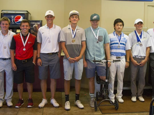 The top-10 golfers from Region 9 pose with their medals at Southgate Golf Club on Wednesday. Desert Hills, Dixie, Snow Canyon and Pine View will head to Soldier Hollow next week for the state tournament.