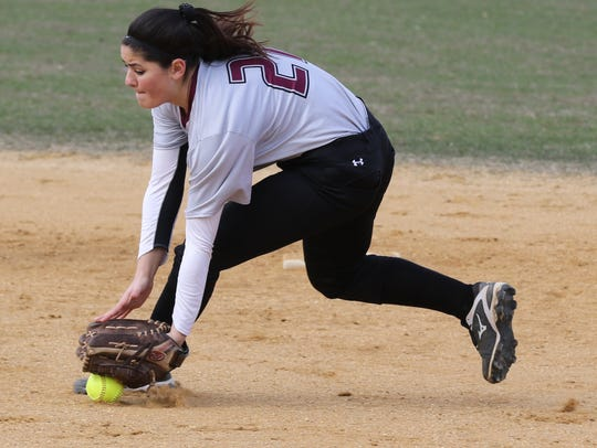 Amber Servidio stops the ball while playing at second