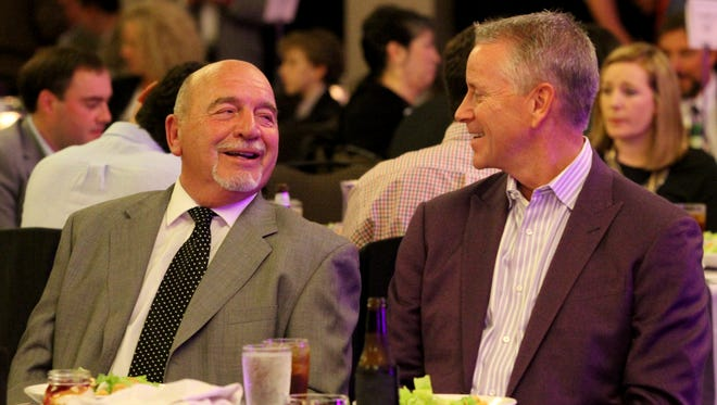 Tom Glavine, right, former pitcher for the Atlanta Braves, talks with former Braves pitching caoch Leo Mazzone at the Hyatt Regency in downtown Greenville during the Furman University Baseball Upstate Diamond Classic Wednesday night, February 8, 2017.