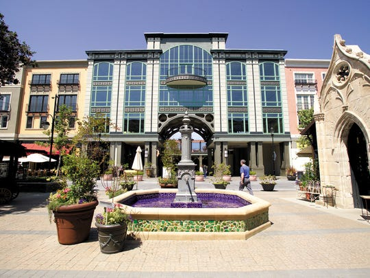 Santana Row, the 42-acre San Jose, California, development with Mediterranean-themed streets, made a deep impression on the Ilitches.