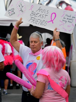 FILE PHOTO: Greg Dziadon holds up a sign to help rangle his wife's team together before the Making Strides Against Breast Cancer Walk at Cordova Mall.