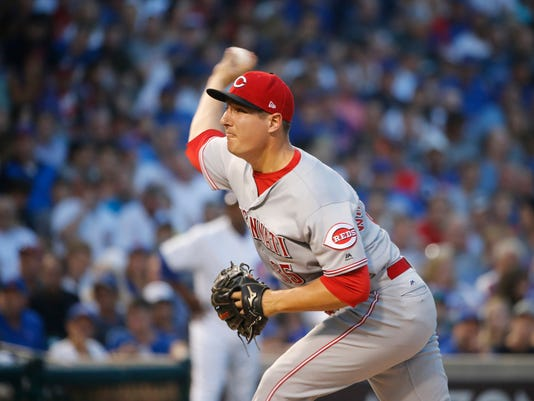 Cincinnati Reds starting pitcher Asher Wojciechowski delivers during the first inning of a baseball game against the Chicago Cubs, Monday, Aug. 14, 2017, in Chicago. (AP Photo/Charles Rex Arbogast)