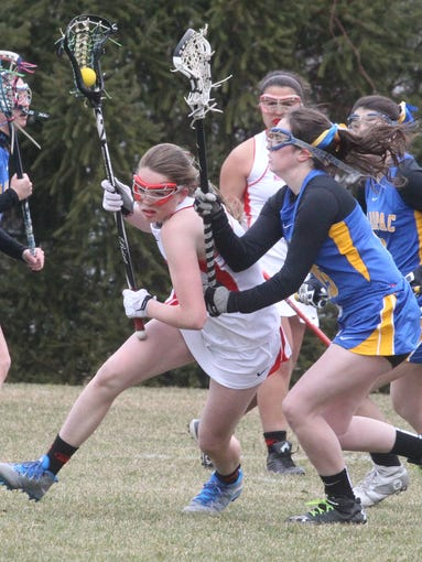 North Rockland's Mairead Durkin is guarded by Mahopac's Katie Semenetz during their lacrosse game at North Rockland April 5, 2014. North Rockland won 11-5.