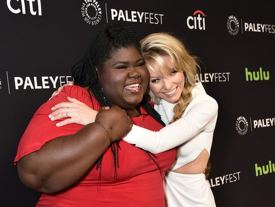 Kaitlin Doubleday, right, hugs her 'Empire' co-star