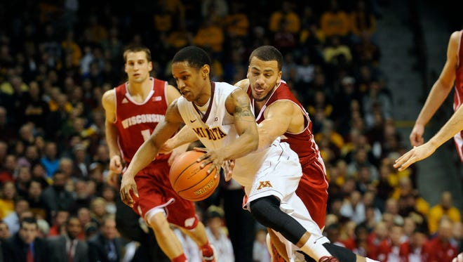 Jan 22, 2014; Minneapolis, MN, USA; Minnesota Gophers guard Deandre Mathieu (4) drives across court as Wisconsin Badgers guard Traevon Jackson (12) reaches for the ball in the second half at Williams Arena.  The Gophers defeated the Badgers 81-68.