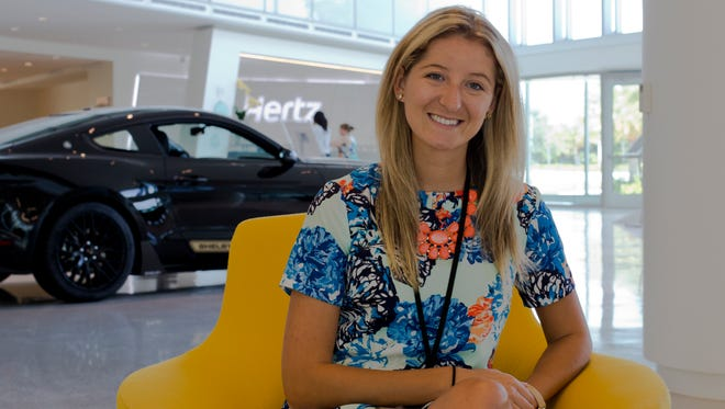 Colleen Lerner sits at Hertz Headquarters in Estero on Aug. 10, 2016. Lerner started as an intern a couple months ago and was recently hired by the company full time.