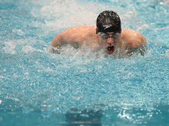 Lexington's Wilson Cannon en route to winning a medal in his specialty, the 100 butterfly.