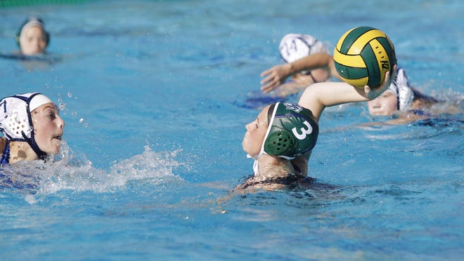 El Diamante's Makenzie Huskey takes a shot on goal against Redwood in the Central Section Division II championship game. Huskey is the 2016 Times-Delta/Advance-Register All-Tulare County Girls Water Polo Player of the Year.