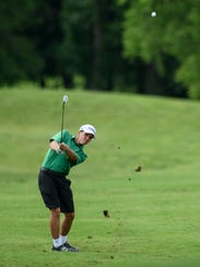 North's James Hevron hits along the fairway during