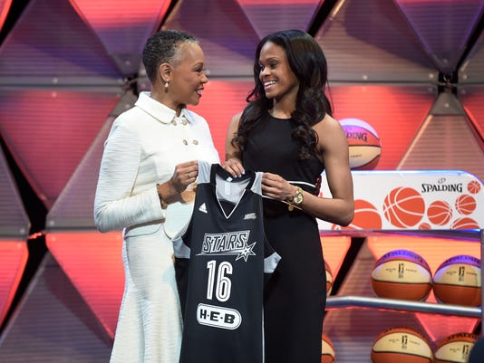 CORRECTS TO LISA BORDERS, INSTEAD OF LESLIE BORDERS  - Connecticut's Moriah Jefferson, right, and WNBA President Lisa Borders hold a San Antonio Stars jersey after Jefferson was selected with the second pick in the WNBA basketball draft Thursday, April 14, 2016, in Uncasville, Conn. (Cloe Poisson/Hartford Courant via AP) MANDATORY CREDIT