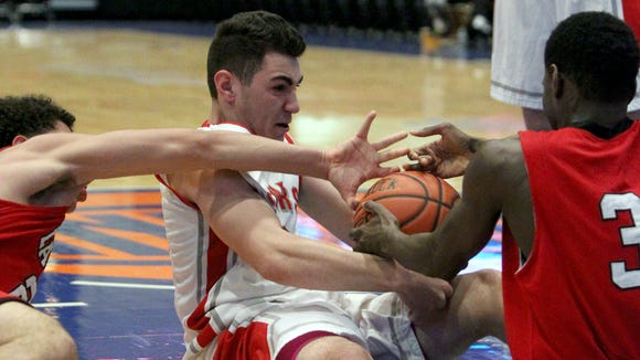 Somers' Lorenzo Bicknese fights for a loose ball with