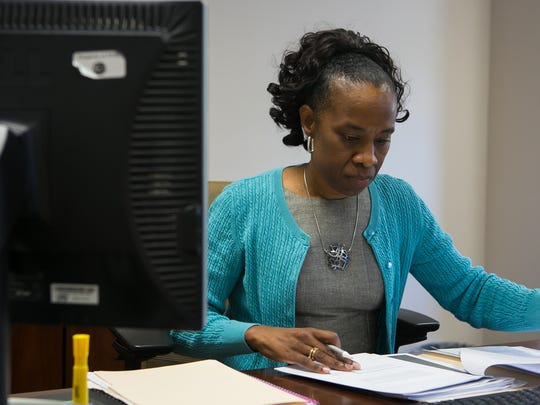 Tamera Fair, the new executive director of the Wilmington Hope Commission, works in her office.