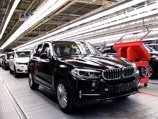 Older model BMW X5 vehicles roll off the assembly line