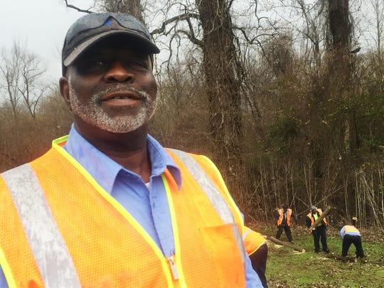 Calvin Evans and a maintenance crew remove dead, fallen