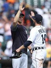 Manager Brad Ausmus high fives centerfielder Alex Presley after the Tigers' 6-2 win July 6, 2017 at Comerica Park.