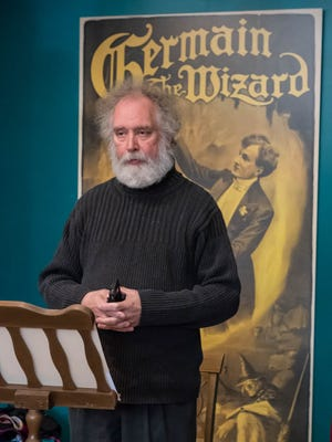 Phillip Hagerty, magician, spoke during the séance for Houdini at the American Museum of Magic in Marshall on Monday.
