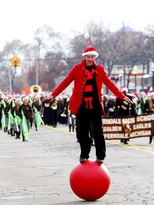 Gene Skalskyj, 41, of Redford, a member of the Detroit Circus, balances on a ball during the Downtown Royal Oak Annual Christmas Parade.