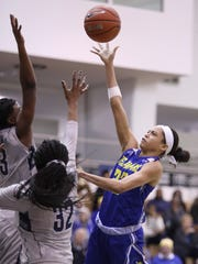 Delaware's Samone DeFreese (right) shoots over Georgetown's Morgan Smith (left) and Yazmine Belk in Delaware's 67-57 WNIT loss at McDonough Arena last season.