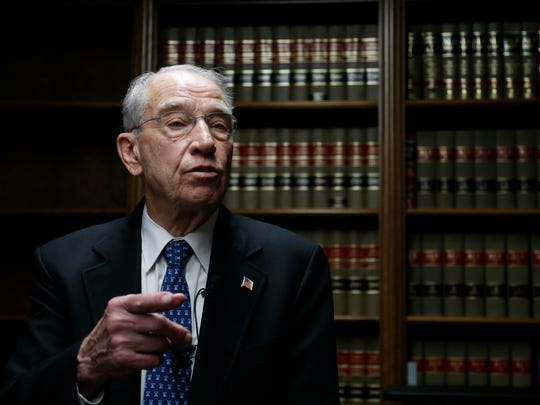 Sen. Chuck Grassley answers questions from members of the media Thursday, Feb. 23, 2017 following a town hall meeting at  the Floyd County Courthouse in Charles City, Iowa.
