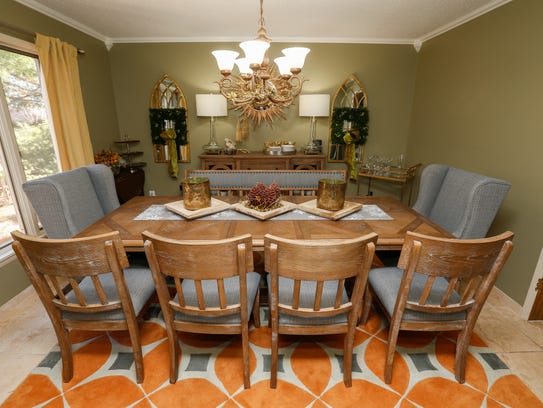 The main floor in Benn Du Mas' home has two dining areas.
