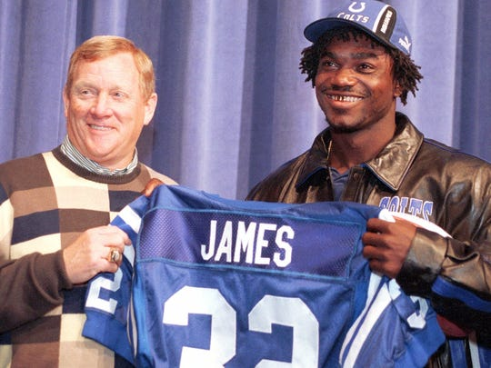 Colts first-round draft pick Edgerrin James smiled as he was given a team jersey by Colts president Bill Polian in 1999. AP Photo/Michael Conroy