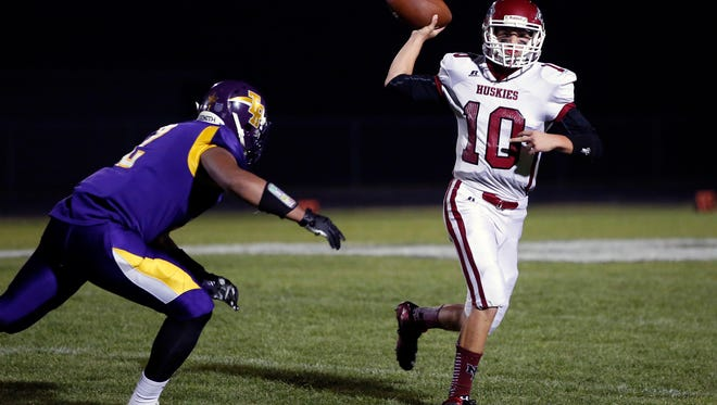 New Holstein quarterback Teddy Schnell looks for an open receiver against Two Rivers last season.