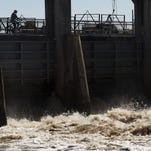 Water released from Lake Okeechobee rushes out of the Ortona Locks along the Calooshatchee River earlier this month. The Army Corps of Engineers is holding a press conference Thursday to give updates on the releases.
