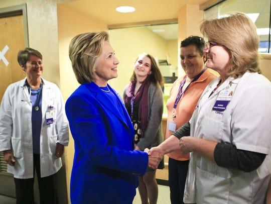 Hillary Clinton greets nurse practitioner Karen Rogers