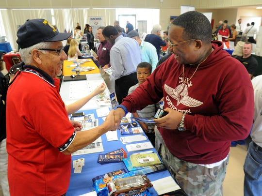 Joe Reyes (left), commander at American Legion Post 48 in Oxnard, greets Army veteran James F. Foster Jr., of Cama­rillo, at Saturday's military and veterans expo and job ­fair.