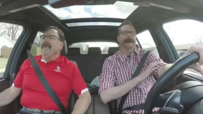 """Lt. Governor Matt Michels and Mitchell Olson talk about mustaches during Olson's """"Carpool Karaoke"""" video he created for the Vermillion Chamber of Commerce."""