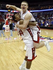 Iowa City High's Malcom Moore carries teammate Matt Gatens as they celebrate the Little Hawks state championship in 2008.