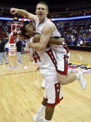 Iowa City High's Malcom Moore carries teammate Matt