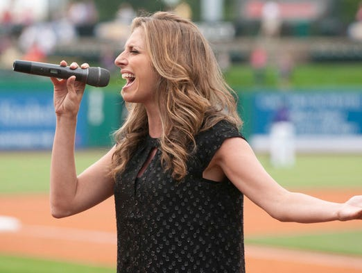 "Janine Stange, ""The National Anthem Girl,"" performs the ""Star Spangled Banner"" before the start of the Bats' game agains the Indians. Stange, a  Long Island, Ny. native is trying to sing the Star Spanged Banner in all 50 states in time for the 200th anniversary of Francis Scott Key penning the lyrics for the hallowed song. This was Stange's 47th performance.    15 August 2014"