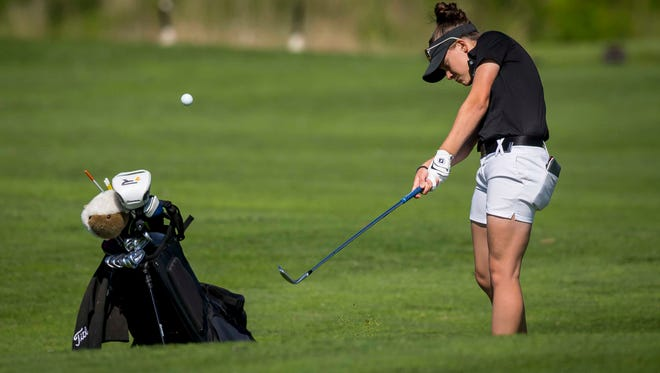 Ankeny Centennial's Tenley Moretti hits on to the 9th green during the 5A Iowa Girls' State Golf Tournament at Coldwater Golf Links in Ames, Iowa, Tuesday, May 30, 2017.