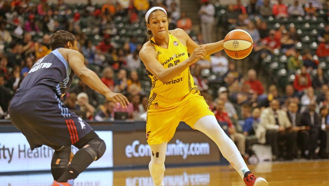 The Indiana Fever's Marissa Coleman (right), pictured during a May 20, 2016, game at Bankers Life Fieldhouse, scored a game-high 19 points Friday night. Minnesota won, however, 82-75.