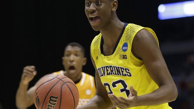Michigan's Caris LeVert reacts to a call during the second half of an NCAA Midwest Regional semifinal against Tennessee Friday, March 28, 2014, in Indianapolis.