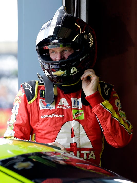 Dale Earnhardt Jr., looks around during the final practice for the NASCAR Cup Monster Energy Series auto race at Chicagoland Speedway in Joliet, Ill., Saturday, Sept. 16, 2017. (AP Photo/Nam Y. Huh)