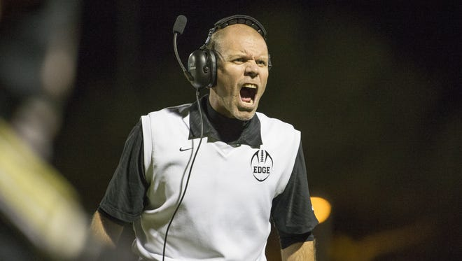 Desert Edge's Rich Wellbrock yells to his team while playing Verrado during the first round of the State Playoffs at Desert Edge High School on November 4, 2016 in Goodyear.