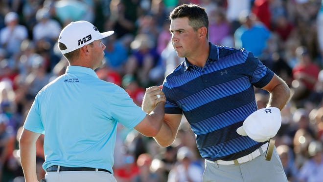 Chez Reavie (left) congratulates Gary Woodland after he won the Waste Management Phoenix Open on the first playoff hole in Scottsdale, Ariz. February 4, 2018.