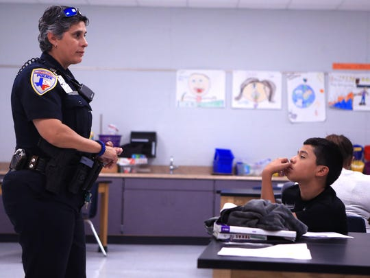 Corpus Christi Independent School District Police Sgt. Janelle Cantu talks with students, including Rudy Herrera, 11, at Metro Elementary School of Design during a meeting of the BullyProof program at the school on May 2, 2017. Students were selected for a program for a variety of reasons, some students were showing bullying tendencies, others had been bullied, Cantu said.