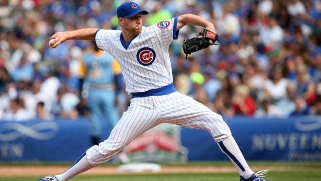 Chicago Cubs relief pitcher Neil Ramirez throws a pitch against the Tampa Bay Rays during the seventh inning at Wrigley Field.
