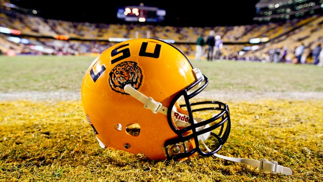 A LSU Tigers helmet sits on the field following a game against the Ole Miss Rebels at Tiger Stadium.