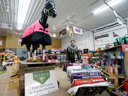 Jess Saari of Windenoak Tack and Feed in Suamico moves an order for delivery to the door January 21, 2016.